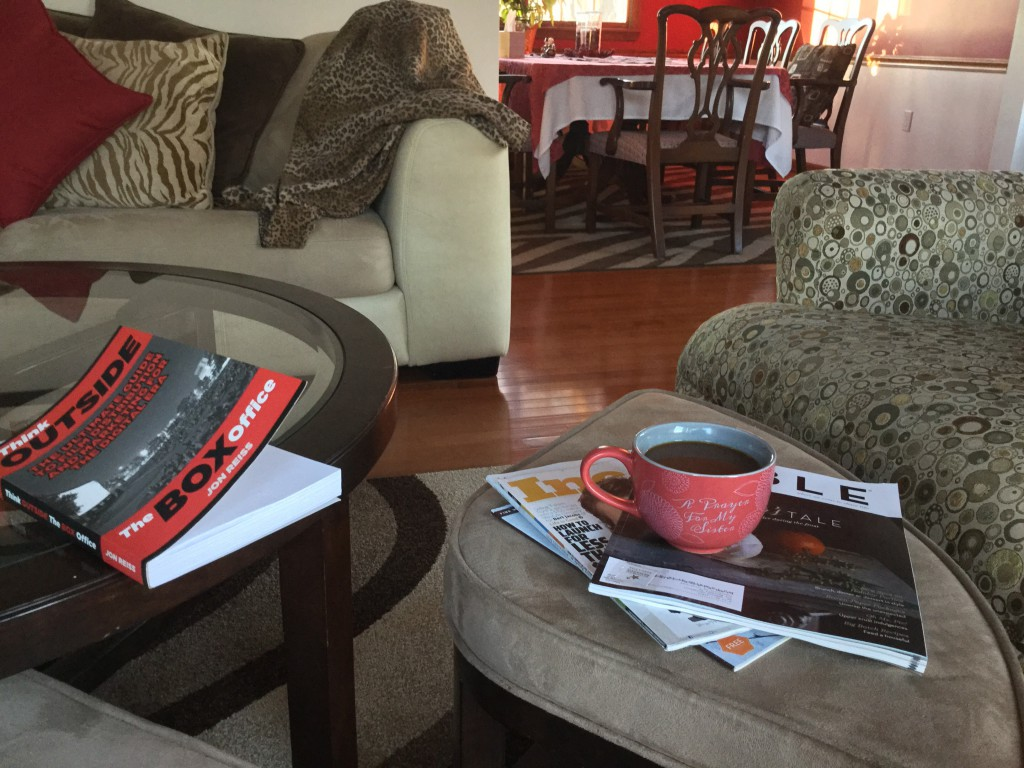Image of coffee table with books and mocha