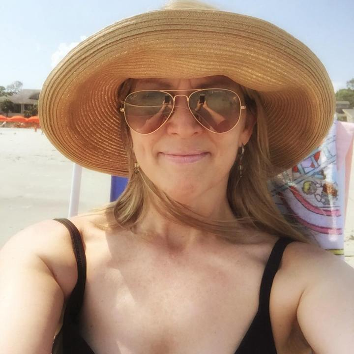 image of author at beach last summer
