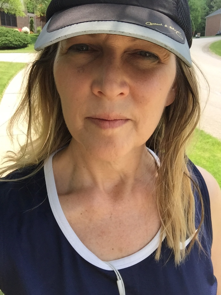 Author outdoors wearing a hat