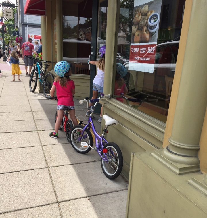 Kids riding bikes on sidewalk